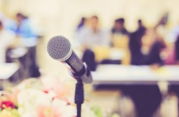 Microphone in front of crowd to help with public speaking